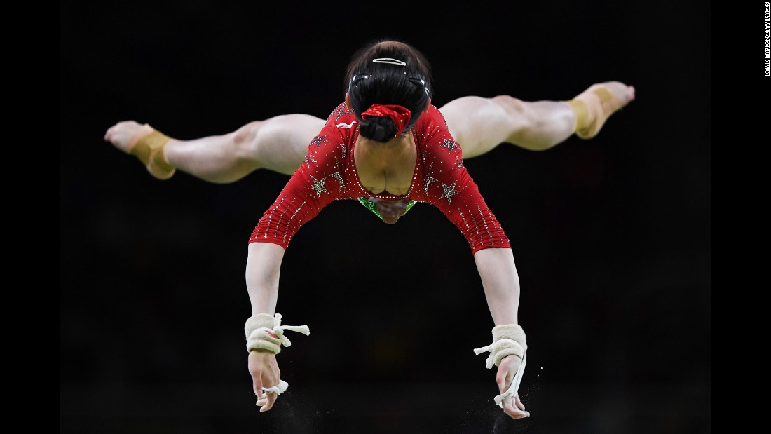 Chinese gymnast Tan Jiaxin competes on the uneven bars on Sunday, August 7.