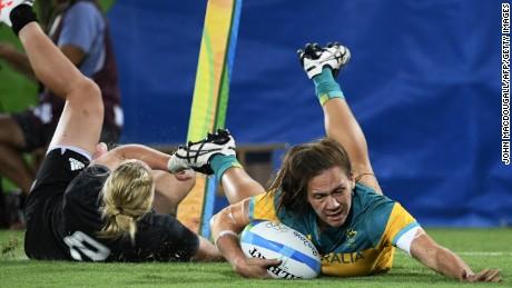 Australia's Evania Pelite scores a try against New Zealand.