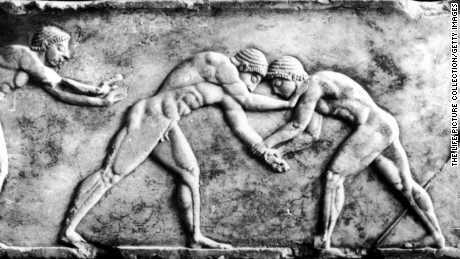 Two wrestlers compete in ancient Olympics.