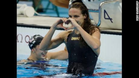Hungary's Katinka Hosszu celebrates winning the gold medal in the women's 100-meter backstroke.