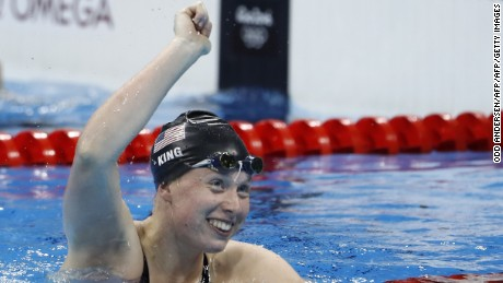 Lilly King celebrates breaking the Olympic record in the Women's 100m Breaststroke
