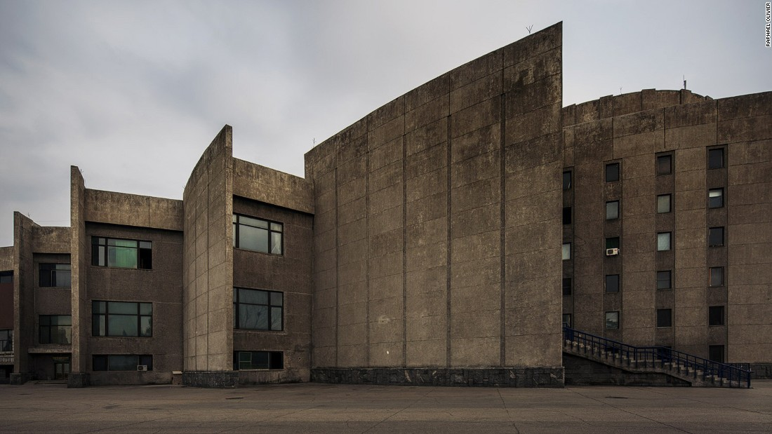 """Photographer <a href=""""http://www.raphaelolivier.com"""" target=""""_blank"""">Raphael Olivier</a> recently went on an architecture tour of Pyongyang. Scroll through the gallery to see and read his thoughts about each building he photographed.<br /><br />(above) """"A gigantic hall featuring several screening rooms able to fit up to 3,000 seats in its largest. It is a pure example of Pyongyang's brutalist architecture. All in bare, raw concrete with modern shapes and sharp edges, brutalist buildings like this one can be found all around the city but this one is probably the most impressive of them all, and could make for a perfect science fiction film set."""""""