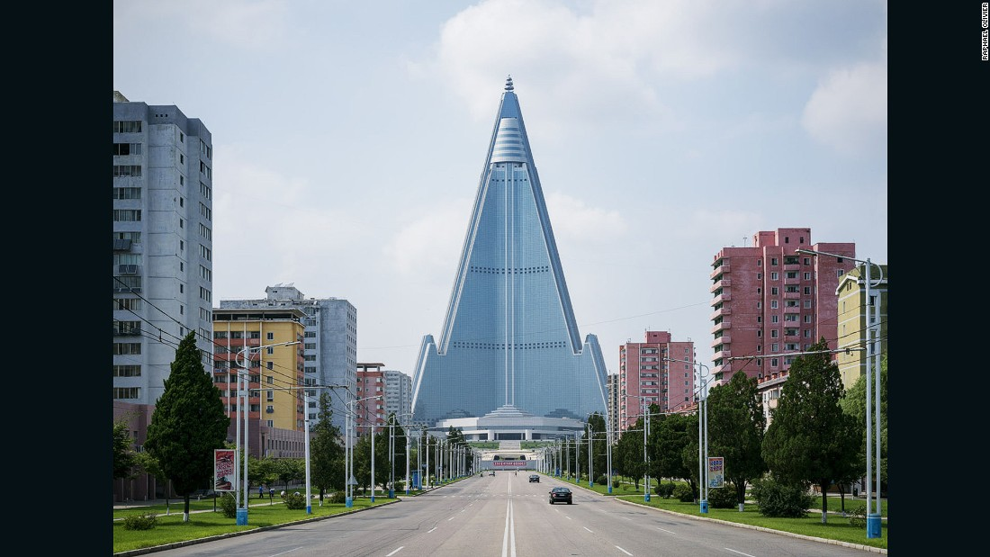 """""""This hotel is probably the most emblematic building of Pyongyang and is still undergoing construction. Towering over the city at 330 meters (1082 feet) high, its infrastructure is made entirely of concrete which gives this solid futurist look -- like a very heavy spaceship that will never take off."""""""