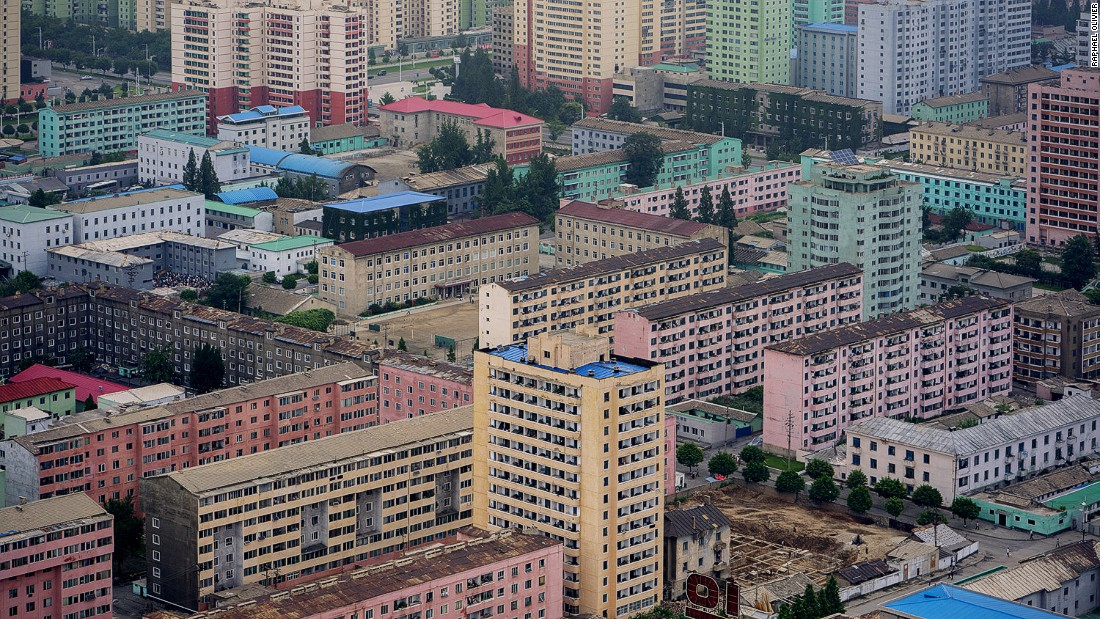 """""""A view of the capital's east seen from Juche Tower. Here the homogenous design of the city and absence of visual pollution from commercial advertising become apparent -- as well as the very linear and raw structures of most buildings."""""""