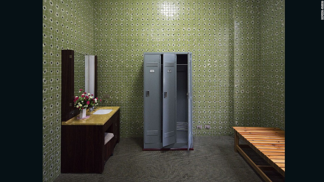 """""""Dressing room of a private sauna at the Changgwang-won health complex, featuring beautiful green tile work with black floor, matching the unique vintage tones of the city."""""""
