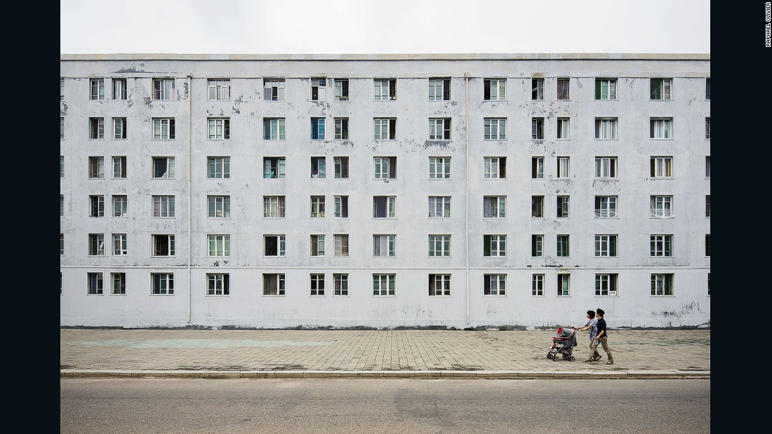 """""""The gray, minimal, and textured facade with grid-like windows was built by the Russians while helping North Korea to rebuild its capital after the Korean War.<strong> </strong>It seemingly has seen many winters, just like the people of this nation."""""""