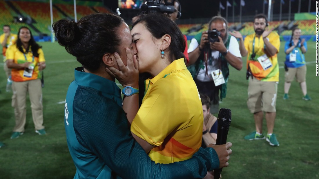 "Rugby player Isadora Cerullo of Brazil, left, kisses Marjorie Enya, a volunteer at the Games, on Monday, August 8. <a href=""http://edition.cnn.com/2016/08/09/sport/marriage-proposal-olympics-brazil/"" target=""_blank"">Enya proposed to Cerullo</a> after the rugby sevens match between Australia and New Zealand."