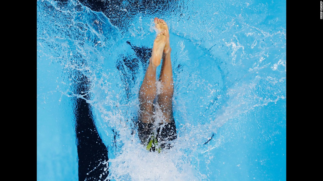 Zimbabwe's Sean Michael Gunn dives in for a 100-meter freestyle race.