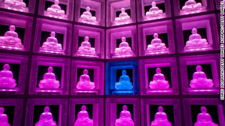 A  glass buddha alter is lit up at the Ruriden columbarium in Tokyo, Japan. The Ruriden, operated by the Koukokuji buddhist temple, took two years to build and houses 2,046 futuristic alters with glass buddha statues that correspond to drawers storing the ashes of the deceased.