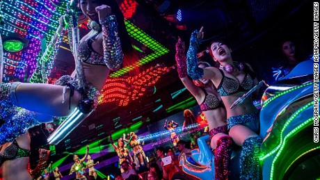 TOKYO, JAPAN - JUNE 29: Dancers dressed as futuristic characters perform during a show at The Robot Restaurant on June 29, 2014 in Tokyo, Japan. The now famous Robot Restaurant opened two years ago in Kabukicho area of Shinjuku at an estimated cost of 10 million U.S. dollars.  Performances are held three times a day and cater mostly to foreign tourists. The cabaret style shows include bikini clad futuristic dancers, performers dressed as robots and a host of large scale robots and vehicles controlled with remotes by stage hands dressed as Ninjas  (Photo by Chris McGrath/Getty Images)