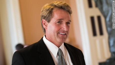 Sen. Jeff Flake (R-AZ) walks to a Senate joint caucus meeting, on Capitol Hill, July 15, 2013 in Washington, DC.
