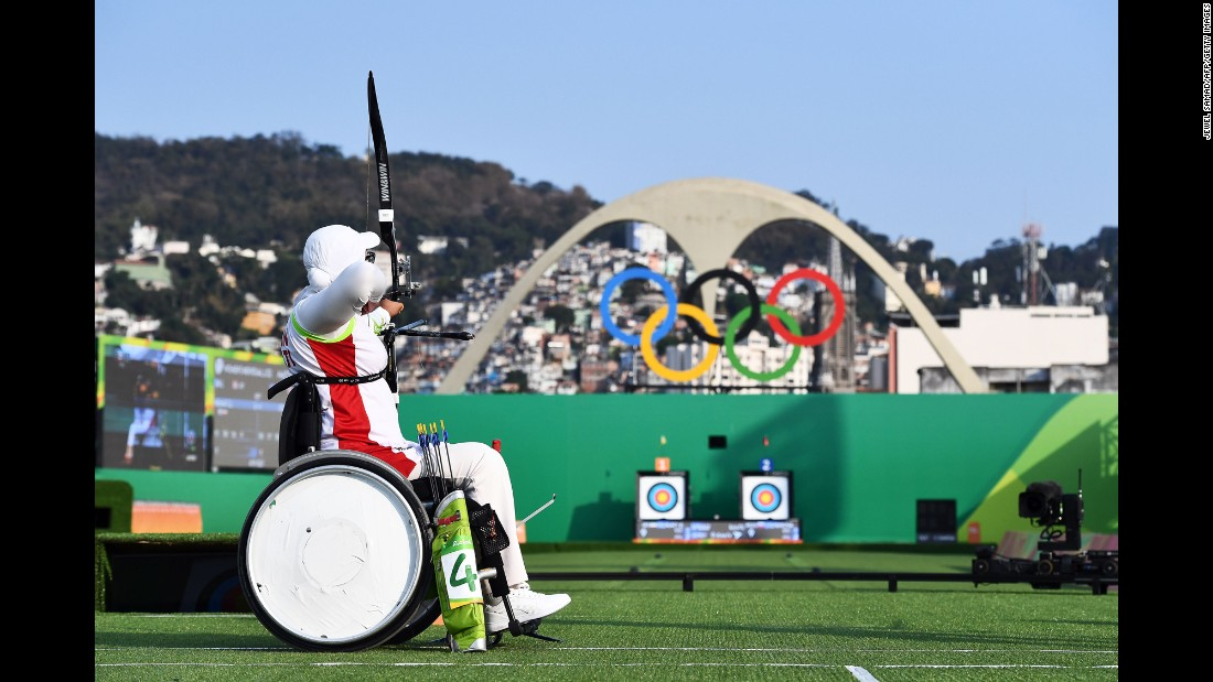 Iran's Zahra Nemati shoots an arrow during the women's individual archery competition.