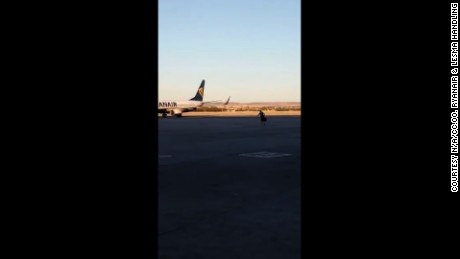 The passenger sprinted across tarmac to try and catch his plane.
