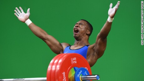 Colombia's Oscar Albeiro Figueroa Mosquera celebrates after he won the Men's 62kg weightlifting competition at the Rio 2016 Olympic Games in Rio de Janeiro on August 8, 2016.  / AFP / GOH Chai Hin        (Photo credit should read GOH CHAI HIN/AFP/Getty Images)