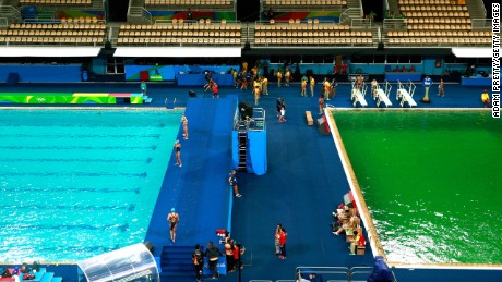 The green diving pool at Maria Lenk Aquatics Centre next to another that is the usual color - although that too later turned green