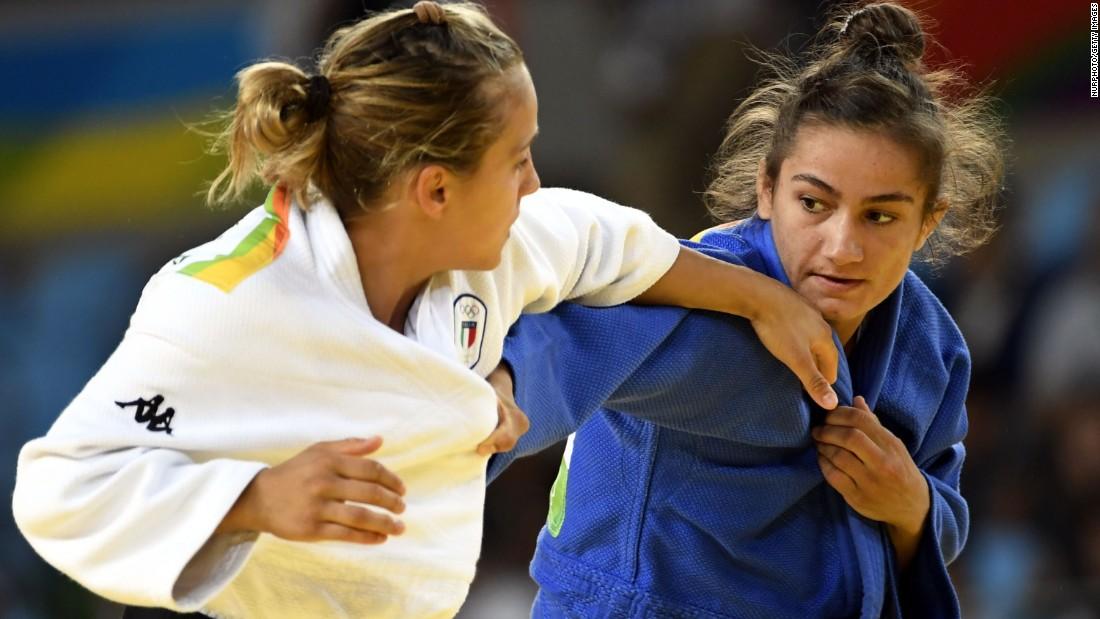"Kosovo's Majlinda Kelmendi, right, defeated Italy's Odette Giuffrida in the 52-kilogram (115-pound) judo final. It is <a href=""http://www.cnn.com/2016/08/07/sport/majlinda-kelmendi-kosovo-olympics/index.html"" target=""_blank"">the first Olympic medal</a> in Kosovo history."