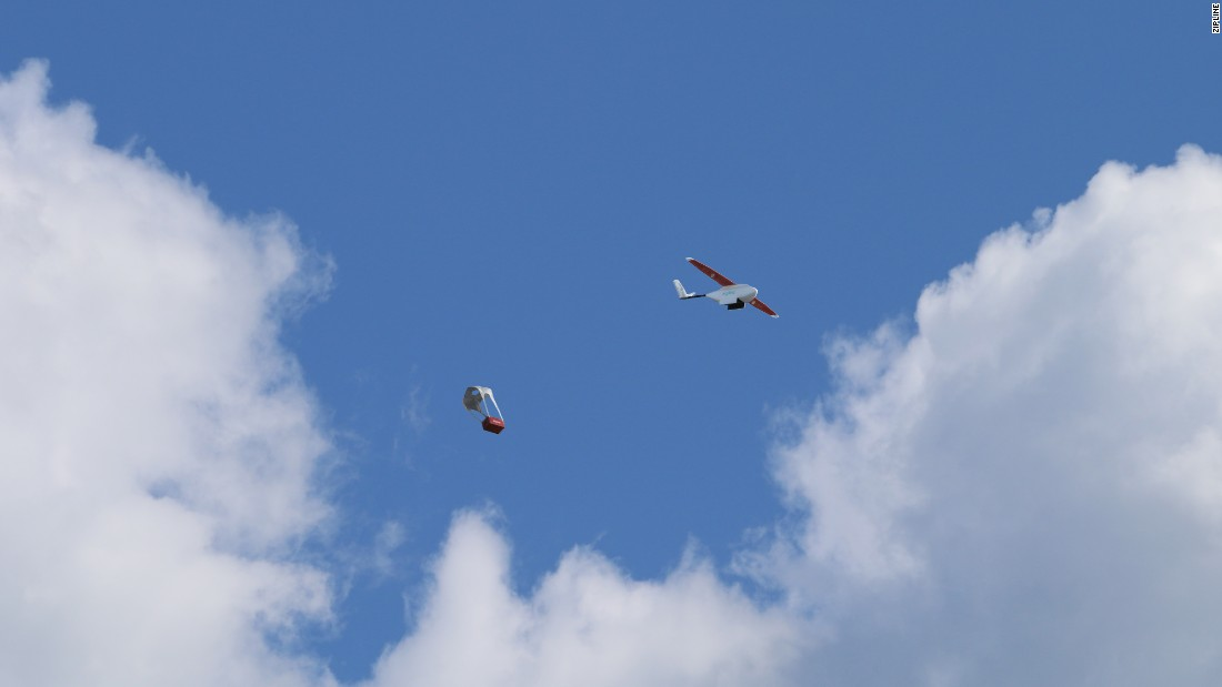 The Zipline drone ejects a blood package that floats to earth on a mini-parachute.