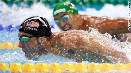 Chad le Clos looks on as Michael Phelps goes on to win gold.