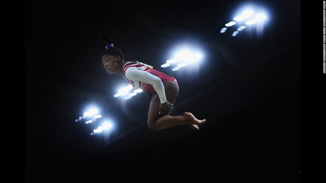"Her ability to jump high and maintain momentum in midair comes from a combination of her short stature and great strength. That's one reason why you'll see Biles perform so many ""double-doubles."" A double-double is a challenging double-twisting, double-back somersault tumbling move. You need to jump very high to have time to do all that twisting and flipping. Biles packs a lot of power into her 4 feet, 8 inches."