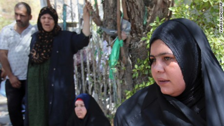 Bereaved family members of the dead infants gather outside Yarmouk hospital Wednesday.