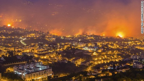 A wildfire threatens Funchal, the capital of Madeira, on Tuesday night.