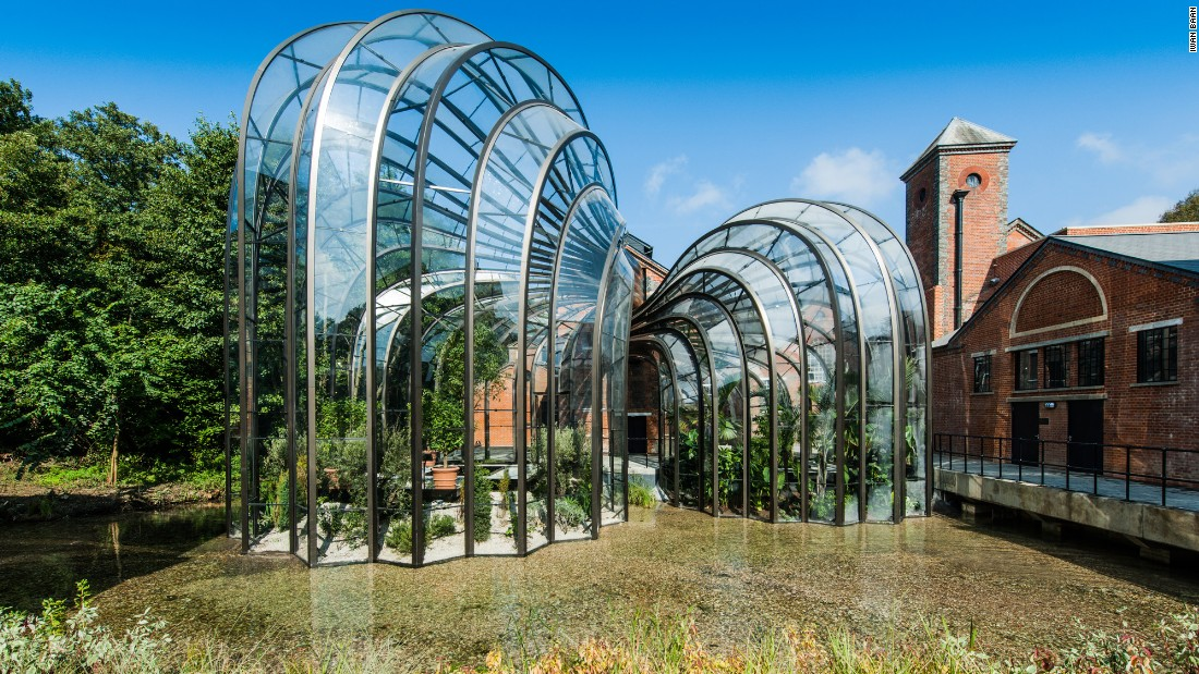 """Opened to the public in late 2014, the new Bombay Sapphire Distillery by <a href=""""http://www.heatherwick.com/distillery/"""" target=""""_blank"""">Heatherwick Studio</a> straddles the River Test in the village of Laverstoke, England. Two intertwining botanical glasshouses are a highlight of the central courtyard -- one tropical and the other Mediterranean -- housing and cultivating the 10 plant species that give Bombay Sapphire gin its particularity."""
