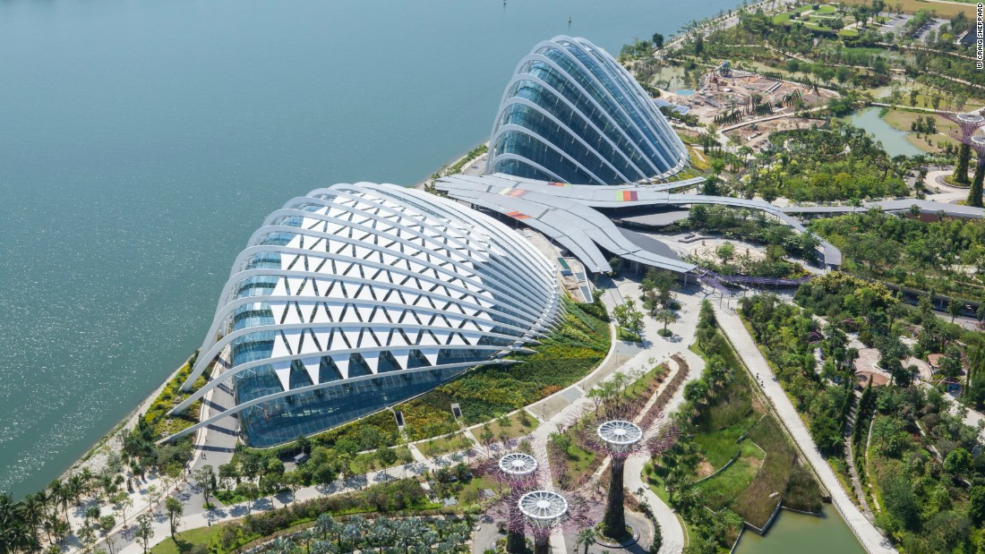 """In 2006, <a href=""""http://www.wilkinsoneyre.com/"""" target=""""_blank"""">WilkinsonEyre</a> was part of a British-led team that won the design competition for the masterplan for Singapore's Gardens by the Bay. Tasked with designing a horticultural attraction and showcase for sustainable technology, they created the Cooled Conservatory Complex. The two main conservatory structures are among the largest climate-controlled glasshouses in the world, covering an area in excess of 20,000 square meters (215,000 square feet)."""