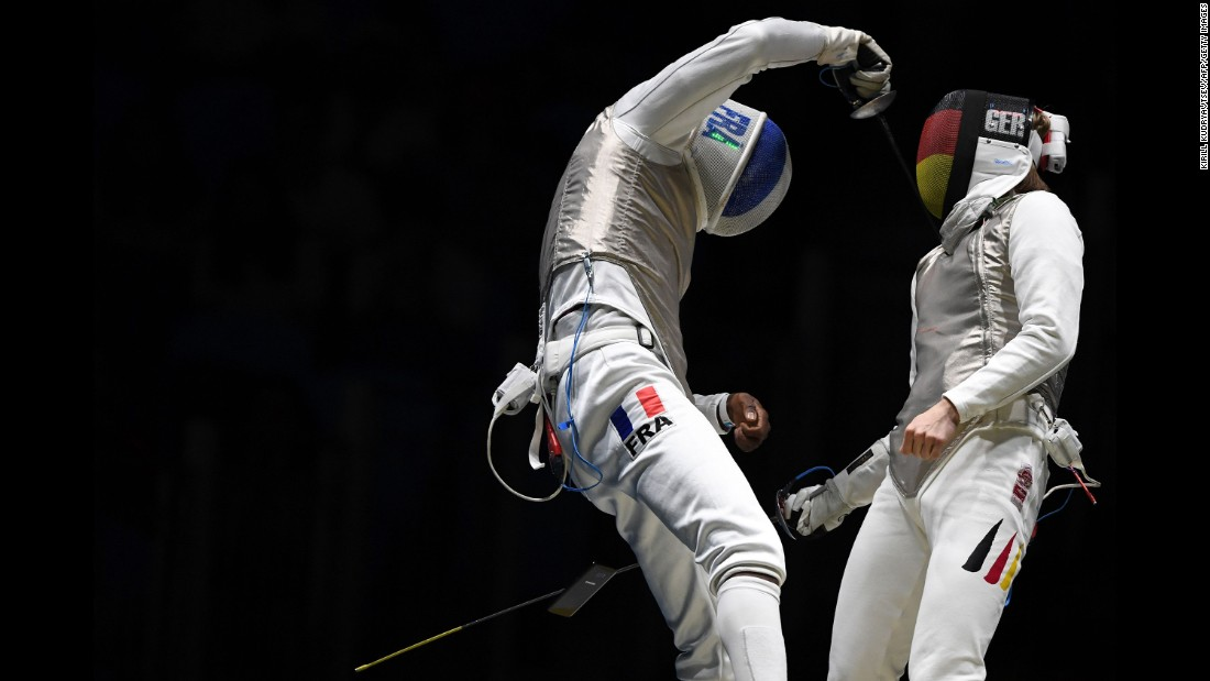 "A cell phone <a href=""http://www.cnn.com/2016/08/09/sport/french-fencer-drops-phone/"" target=""_blank"">falls out of the pocket of French fencer Enzo Lefort</a> as he competes against Germany's Peter Joppich on Sunday, August 7."