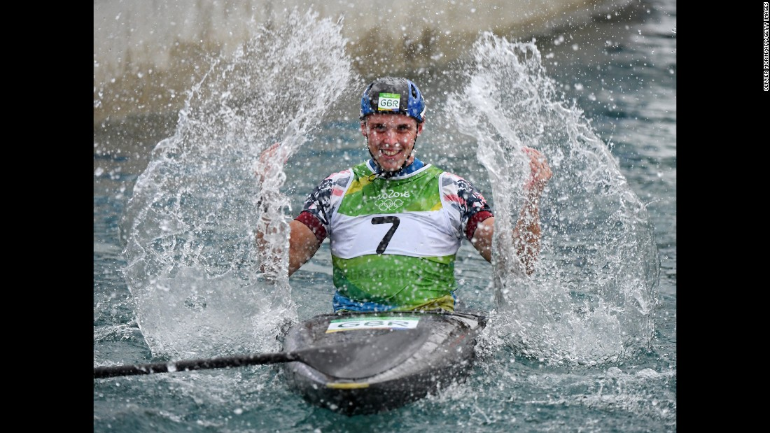 British canoeist Joseph Clarke celebrates after winning the K-1 slalom final.