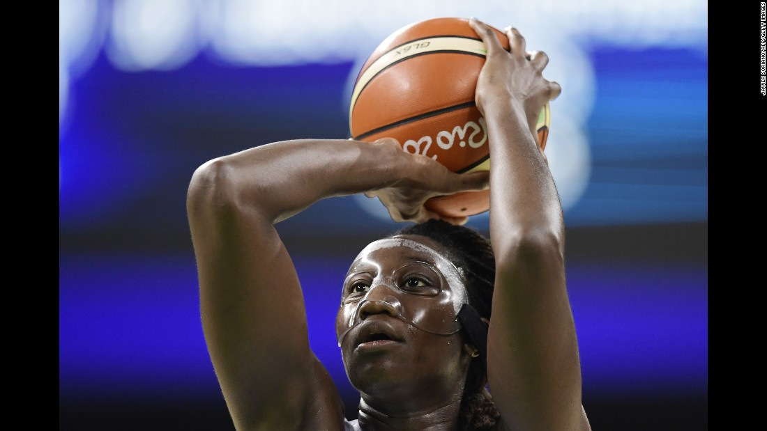 American basketball player Tina Charles shoots a free throw against Serbia.