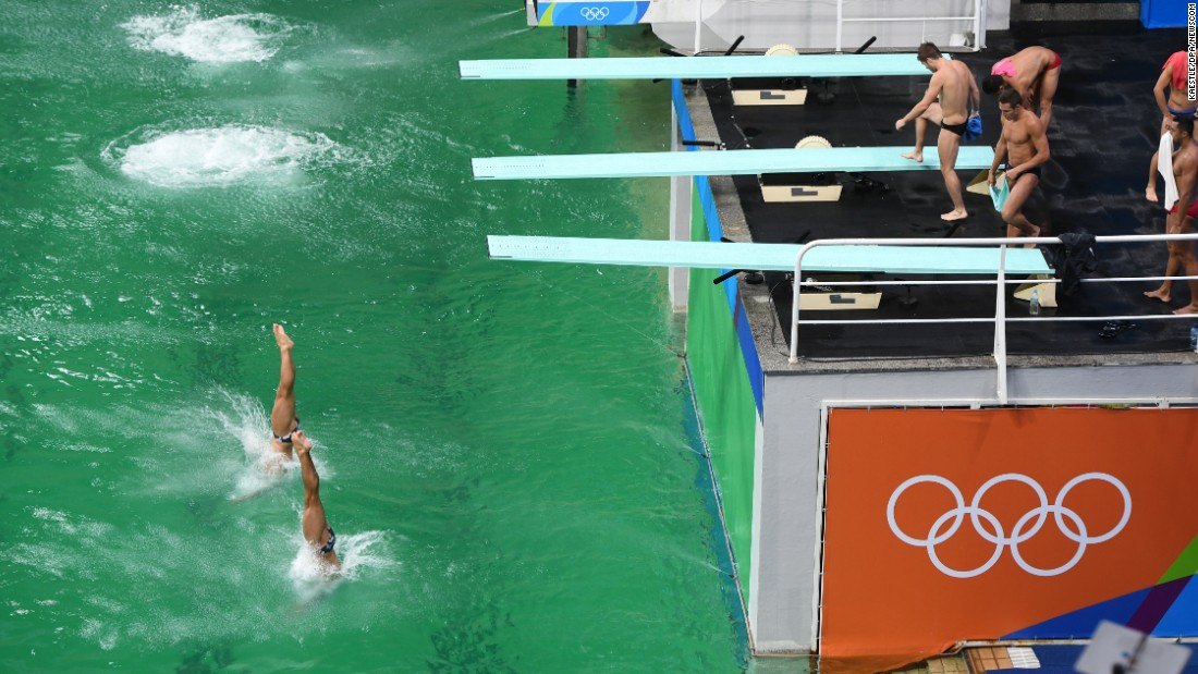 Synchronized divers practice for the 3-meter springboard event.