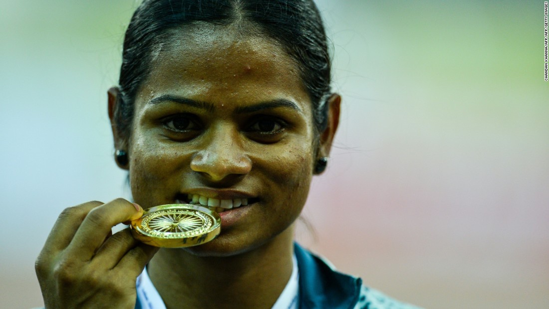 Women with naturally high levels of testosterone (hyperandrogenism) were not allowed to compete in the Olympic Games between 2011 and 2015, until Indian 100m runner Dutee Chand challenged IAAF regulations. Here, Chand poses with her winning medal after victory in the 100 meter race during the Federation Cup National Athletics Championship in New Delhi in 2016.
