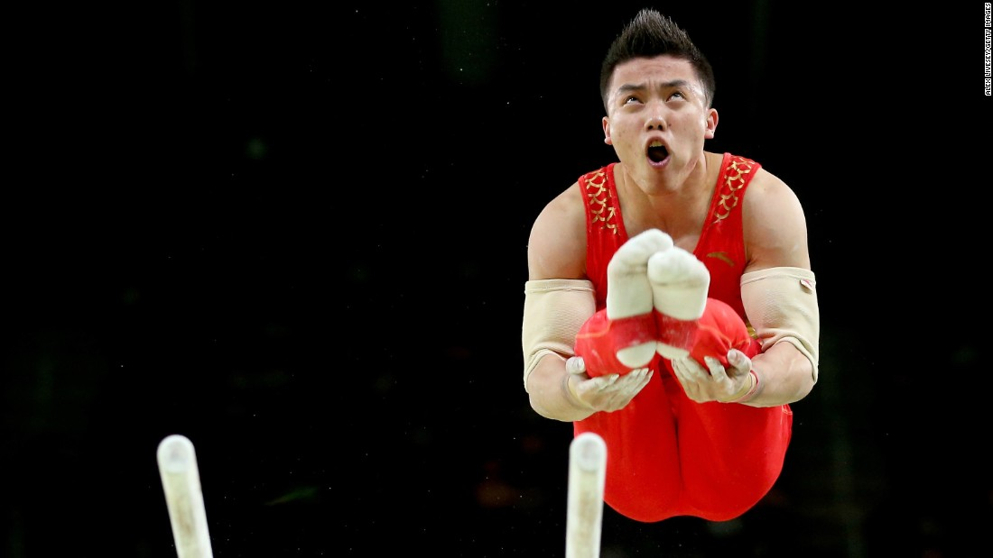 Chinese gymnast Chaopan Lin competes on the parallel bars during the individual all-around.