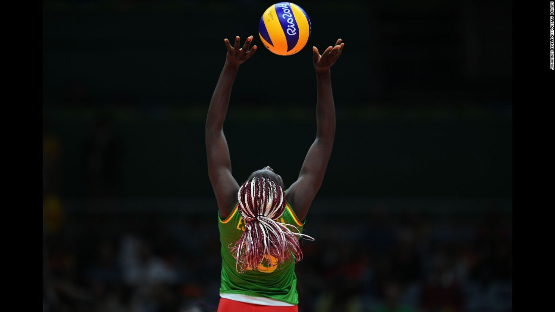 Madeleine Samantha Bodo Essissima plays a shot for Cameroon during a volleyball match against Russia.