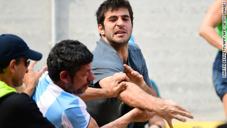 An Argentina fan fights with another fan during the men's second round singles tennis match between Argentina's Juan Martin Del Potro and Portugal's Joao Sousa at the Olympic Tennis Centre of the Rio 2016 Olympic Games in Rio de Janeiro on August 8, 2016. / AFP / Martin BERNETTI        (Photo credit should read MARTIN BERNETTI/AFP/Getty Images)