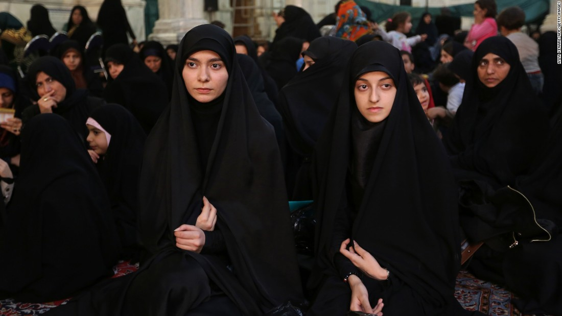 <strong>Chador:</strong> The full-body black garment leaves the face exposed. These Iranian women are wearing chadors at a political meeting in Tehran.