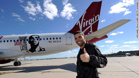 ORONTO, ON - JUNE 29: Rapper Drake poses in front of 'Air Drake' to celebrate Virgin America's first international flight to Toronto at Toronto Pearson International Airport on June 29, 2010 in Toronto, Canada. (Photo by Michael Buckner/Getty Images)