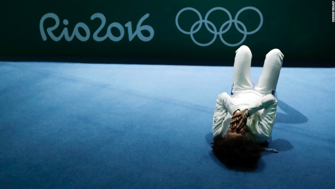 France's Lauren Rembi reacts after her team lost to Russia in their epee quarterfinal.
