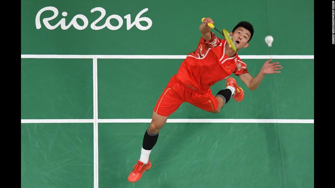 China's Chen Long returns to Sri Lanka's Niluka Karunaratne during a badminton match.