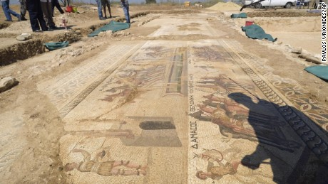 The shadow of Archeologist Fryni Hadjichristofi is cast over a rare mosaic floor dating to the 4th century depicting scenes from a chariot race in the hippodrome
