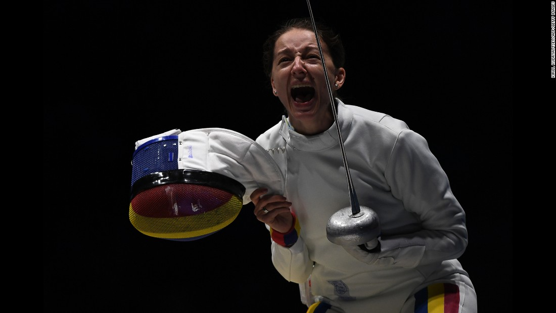 Romania's Ana Maria Popescu celebrates after her fencing team won an epee quarterfinal match against the United States.