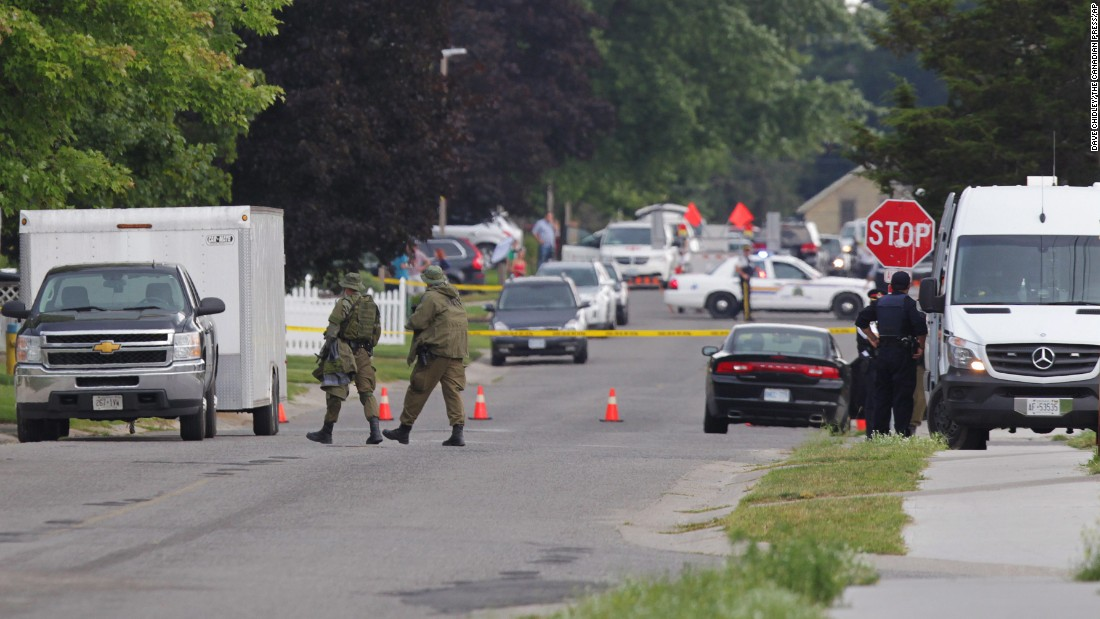Police gather evidence in Strathroy the day after the standoff with Driver. Driver was killed just outside his sister's home.