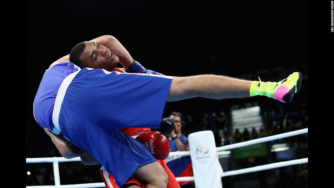 Venezuelan boxer Albert Ramirez, in red, faces Algeria's Abdelhafid Benchabla in a light-heavyweight bout. Benchabla advanced to the quarterfinals.