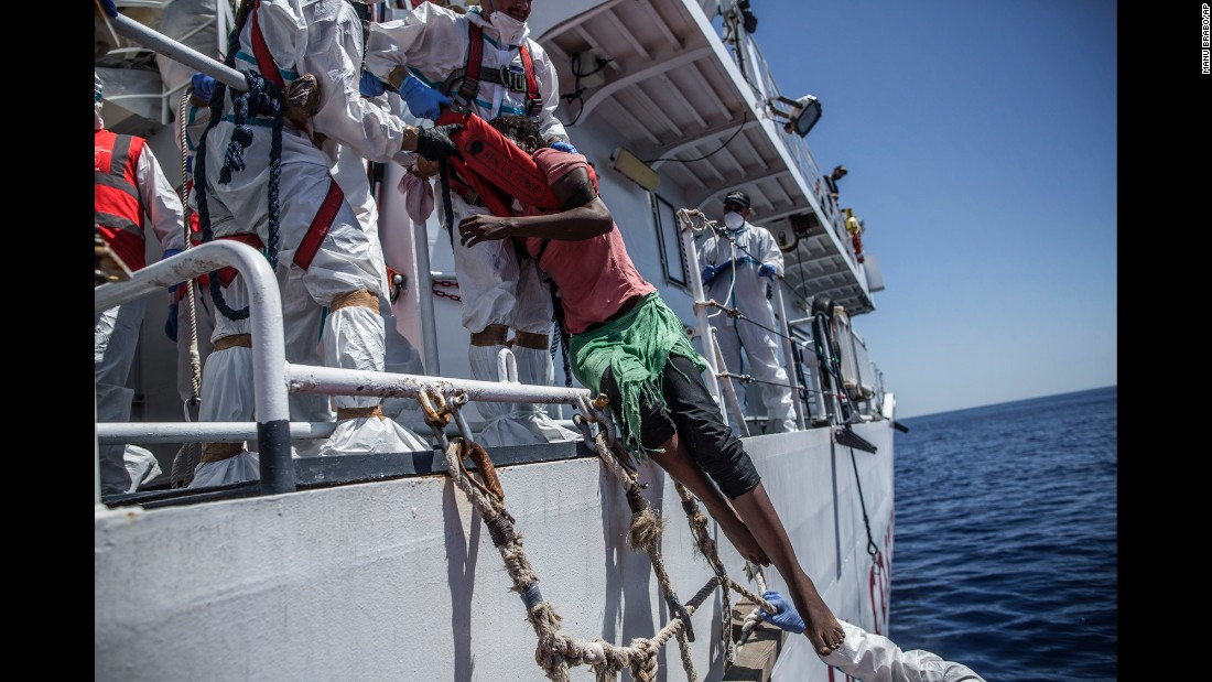 """A migrant is pulled out of the Mediterranean Sea by members of the Italian Coast Guard on Thursday, August 11. <a href=""""http://www.cnn.com/2015/09/03/world/gallery/europes-refugee-crisis/index.html"""" target=""""_blank"""">Photos: Europe's migration crisis</a>"""