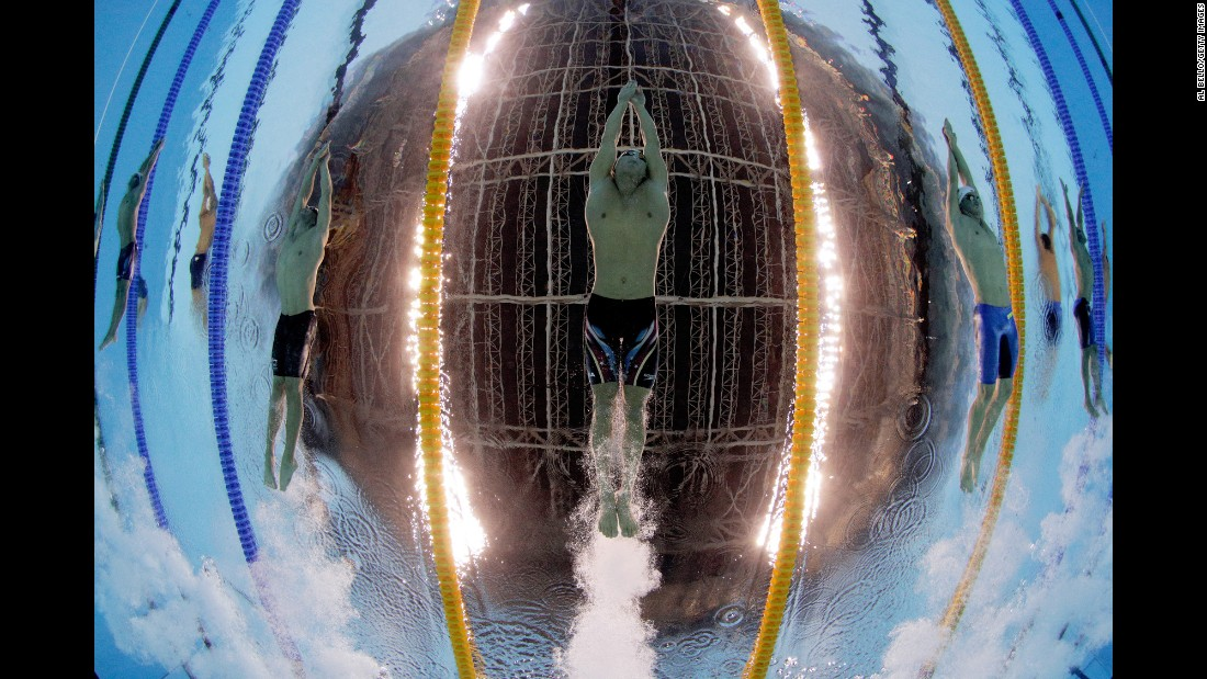 """American Nathan Adrian swims the 100-meter freestyle on Tuesday, August 9. """"It's a very time-consuming, tedious operation to get things correct,"""" Bello said of underwater photography. """"There's a lot of setup way, way, way ahead of time."""""""