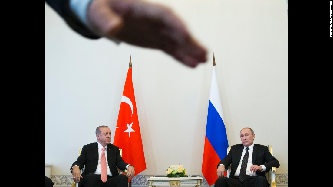 """Russian President Vladimir Putin, right, meets with Turkish President Recep Tayyip Erdogan in St. Petersburg, Russia, on Tuesday, August 9. The two leaders <a href=""""http://www.cnn.com/2016/08/09/world/turkey-russia-erdogan-putin-meeting/"""" target=""""_blank"""">announced they were restoring their bilateral relationship</a> to the levels that existed before last November, when Turkish forces shot a Russian warplane out of the sky near the Syrian border."""
