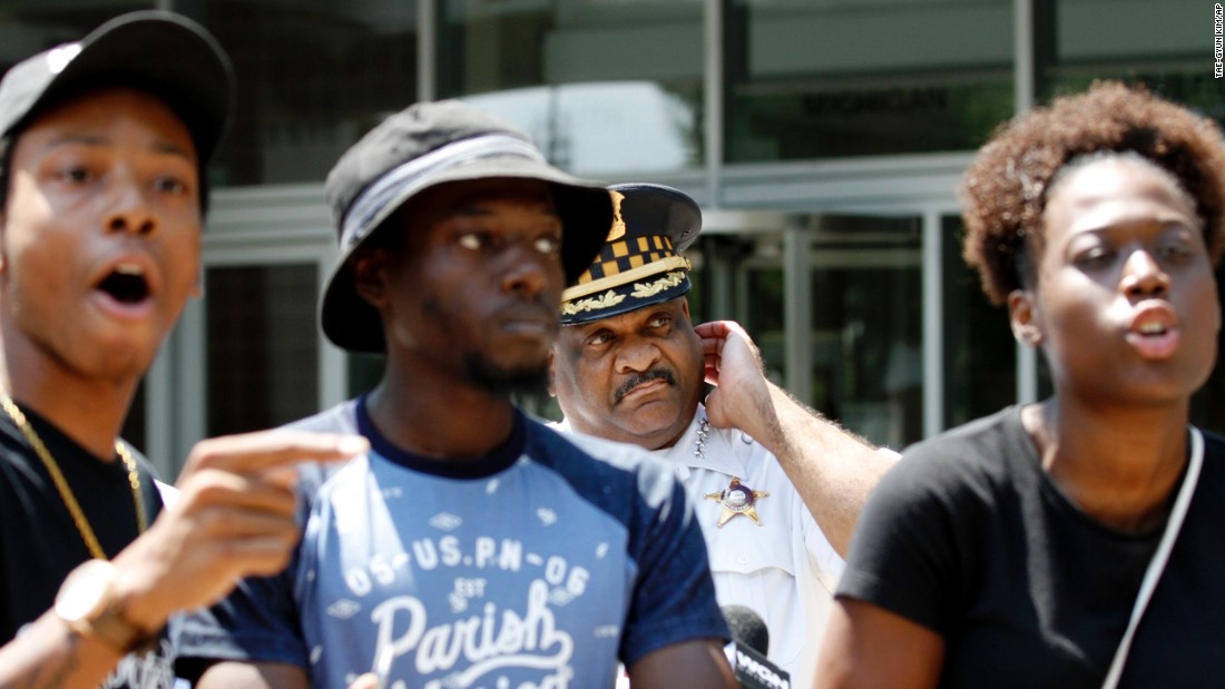 """Chicago Police Superintendent Eddie Johnson, second from right, is blocked by three protesters as he tries to deliver a statement Friday, August 5, about the fatal police shooting of 18-year-old Paul O'Neal. Johnson <a href=""""http://www.cnn.com/2016/08/05/us/chicago-police-shooting-video-release/"""" target=""""_blank"""">vowed """"full cooperation""""</a> in the investigation by the Independent Police Review Authority."""