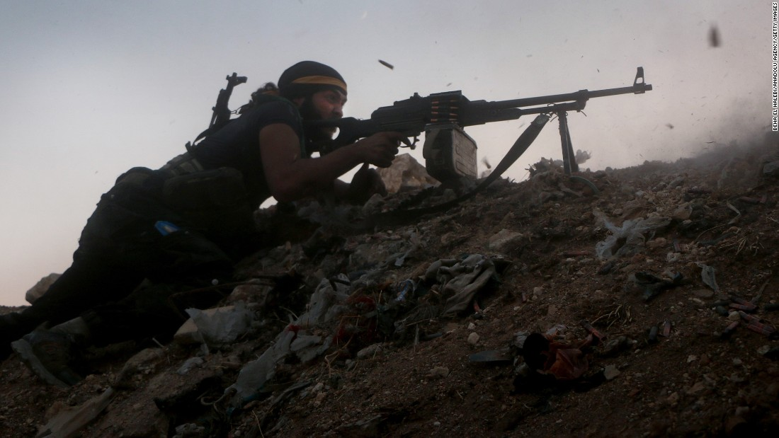 A member of a Syrian opposition group clashes with regime soldiers in Aleppo, Syria, on Saturday, August 6.