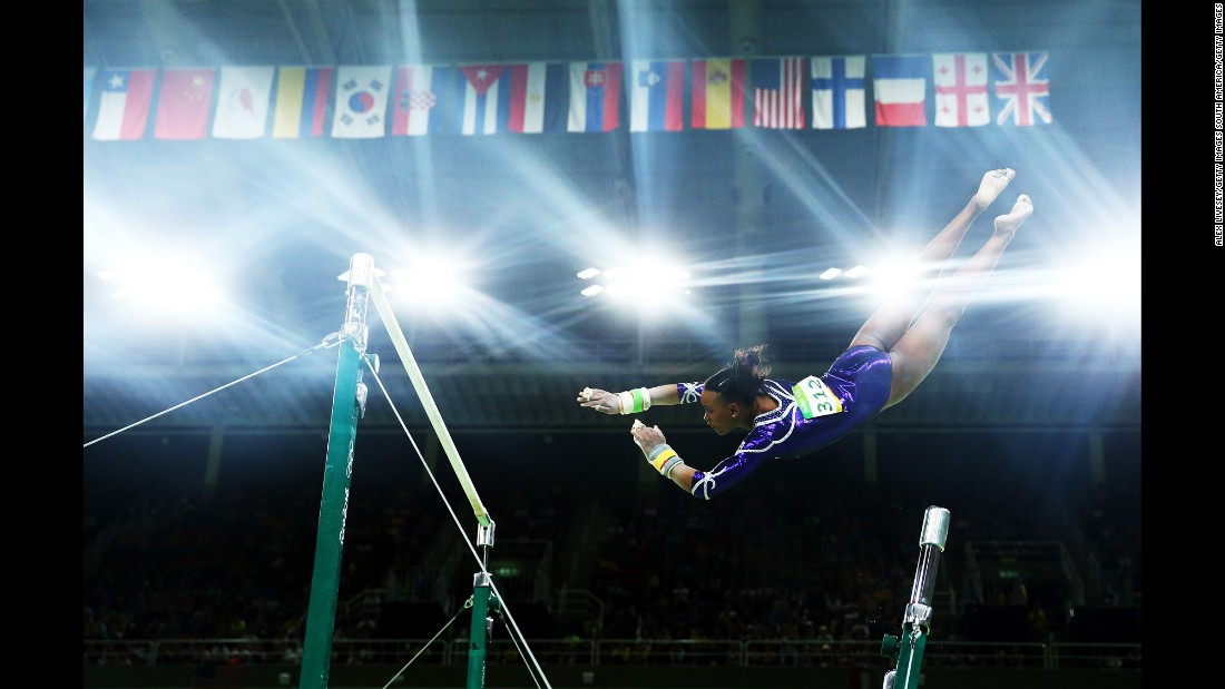 Brazilian gymnast Rebeca Andrade competes on the uneven bars during the individual all-around.
