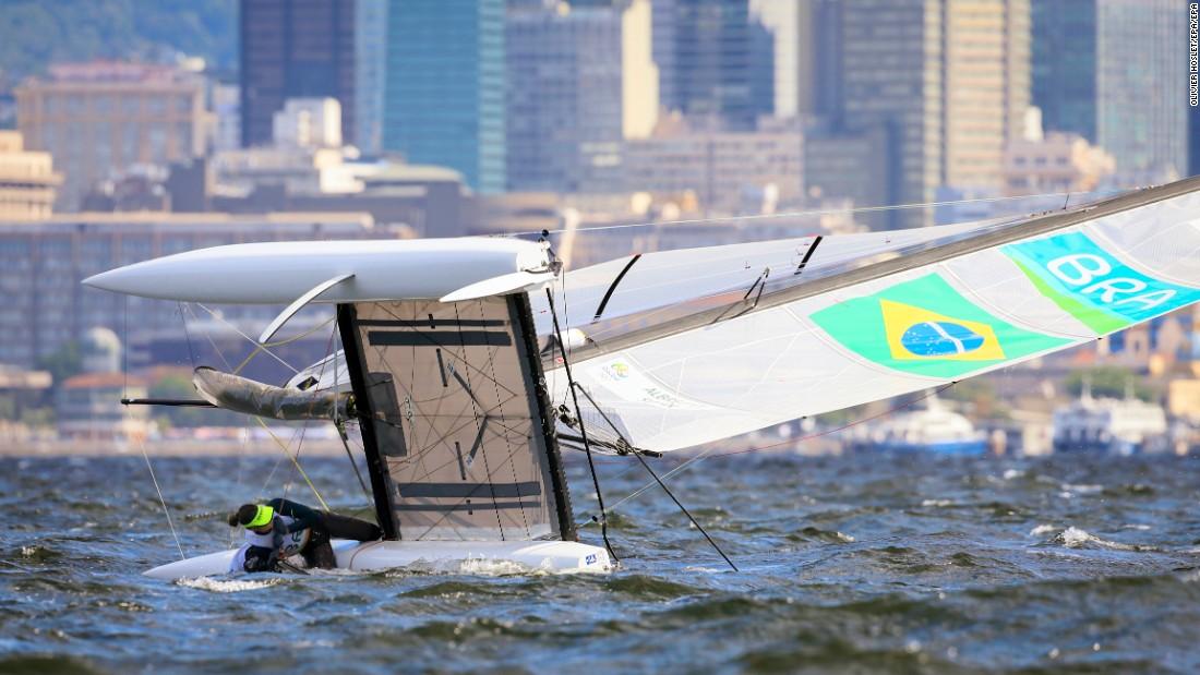 Brazilian sailors Samuel Albrecht and Isabel Swan capsize during the Nacra 17 mixed race.